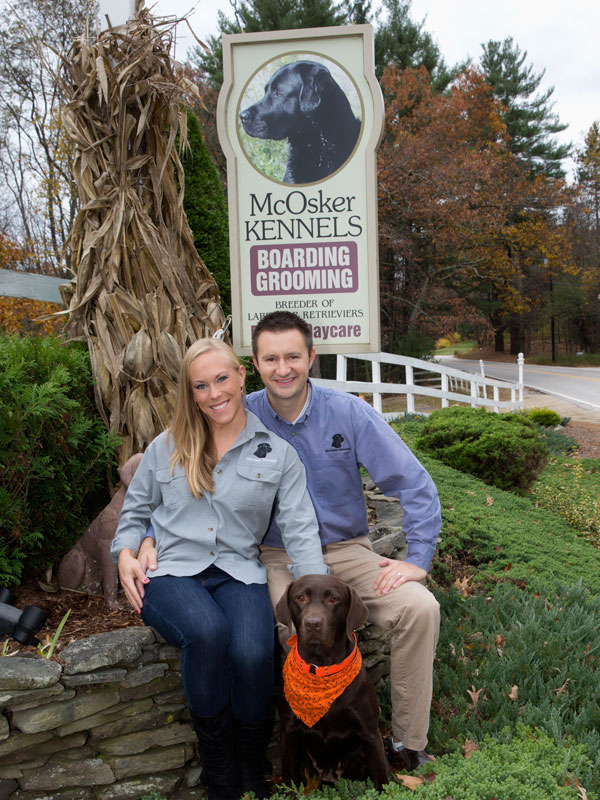 McOsker Kennel Sign with owners