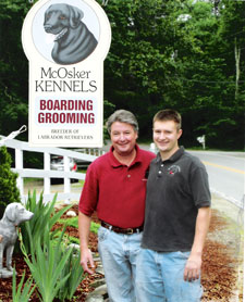 McOsker Kennel Sign with owners Tim and Tim Jr